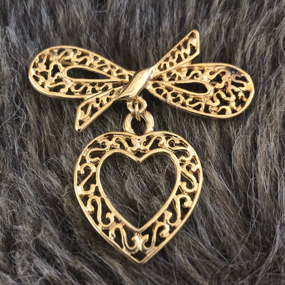 Vintage gold filigree bow with dangle heart brooch